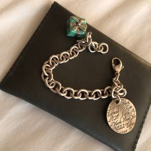 Tiffany & Co. charm bracelet with 2 charms